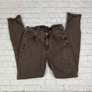 Brown jeans with a raw hem